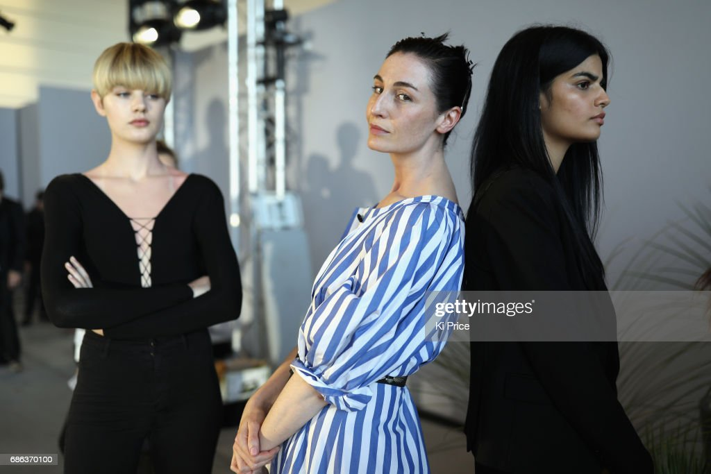 Erin O'Connor (C) backstage at the Fashion for Relief event during the 70th annual Cannes Film Festival at Aeroport Cannes Mandelieu on May 21, 2017 in Cannes, France.