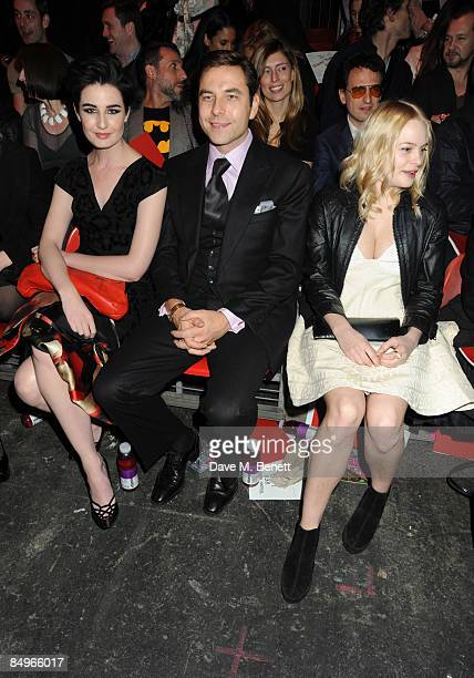 Erin O'Connor David Walliams and Annabelle Horsey pose in the front row for Vivienne Westwood Red Label show during the London Fashion Week a/w 2009...
