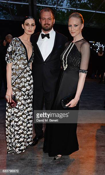 Erin O'Connor Jack Dyson and Jade Parfitt attend British Vogue's Centenary gala dinner at Kensington Gardens on May 23 2016 in London England