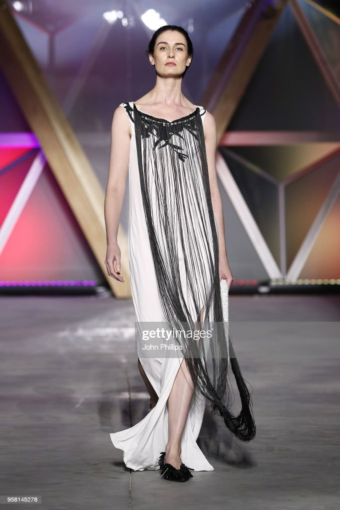Erin O'Connor walks the Runway at Fashion for Relief Cannes 2018 during the 71st annual Cannes Film Festival at Aeroport Cannes Mandelieu on May 13, 2018 in Cannes, France.