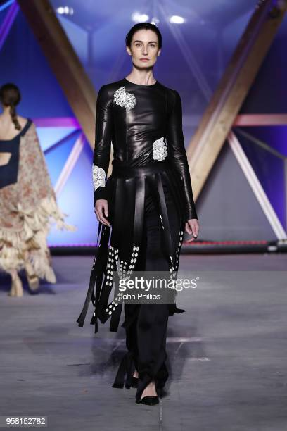 Erin O'Connor walks the Runway at Fashion for Relief Cannes 2018 during the 71st annual Cannes Film Festival at Aeroport Cannes Mandelieu on May 13...