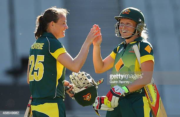 Erin Osborne and Alyssa Healy of Australia celebrate winning game three of the International Women's Twenty20 match between Australia and the West...