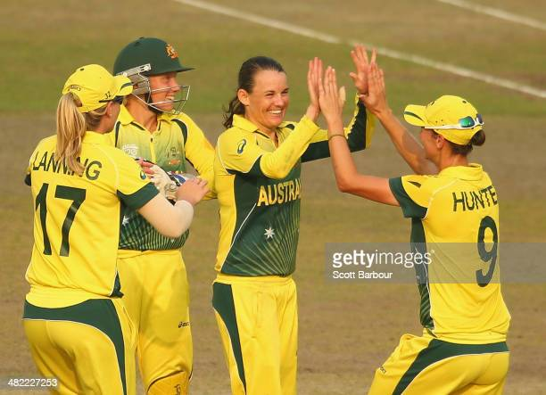 Erin Osborne of Australia is congratulated by her teammates after dismissing Kycia Knight of the West Indies during the ICC Women's World Twenty20...