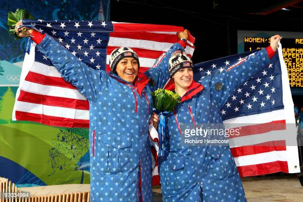 Erin Pac and Elana Meyers of the United States celebrates bronze in the women's bobsleigh on day 13 of the 2010 Vancouver Winter Olympics at the...