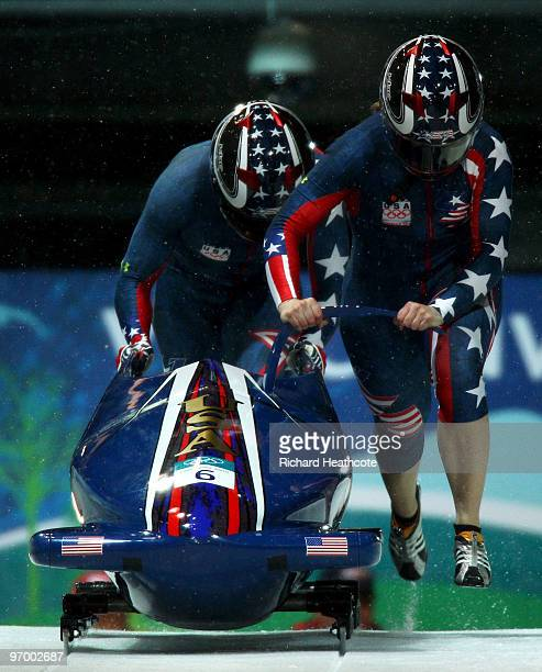 Erin Pac and Elana Meyers of the United States compete in United States 2 during the Women's Bobsleigh Heat 2 on day 12 of the 2010 Vancouver Winter...