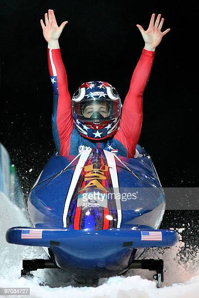 Erin Pac and Elana Meyers of the United States in USA 2 celebrate their fourth run during the women's bobsleigh on day 13 of the 2010 Vancouver...