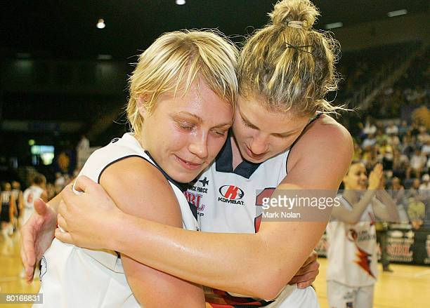 Erin Phillips and Jess Foley of Adelaide embrace after winning the WNBL Grand Final game between the Sydney Uni Flames and the Adelaide Lightning at...