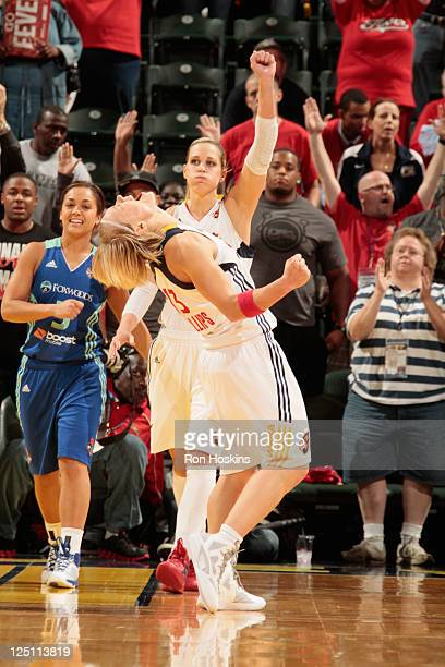 Erin Phillips and Katie Douglas of the Indiana Fever celebrate as the Fever defeated the New York Liberty in Game One of the Eastern Conference...