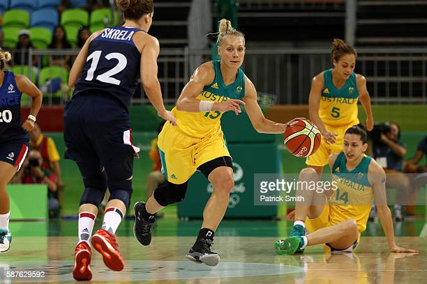 Erin Phillips of Australia dribbles up the court in front of Gaelle Skrela of France in the Women's Preliminary Round Group A match between Australia...