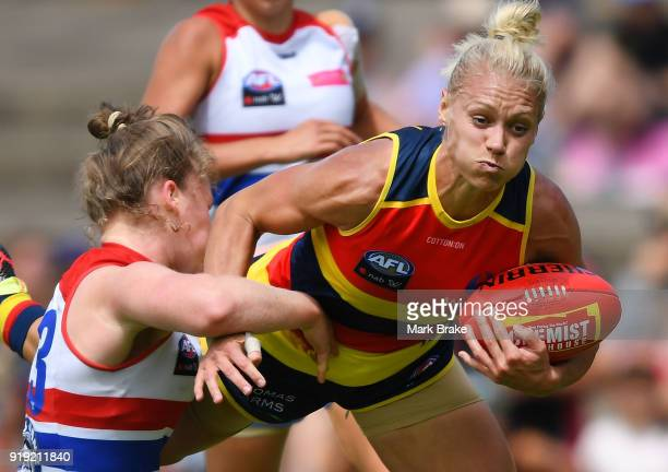 Erin Phillips of the Adelaide Crows tackled by Aisling Utri of the Western Bulldogs during the round three AFLW match between the Adelaide Crows and...