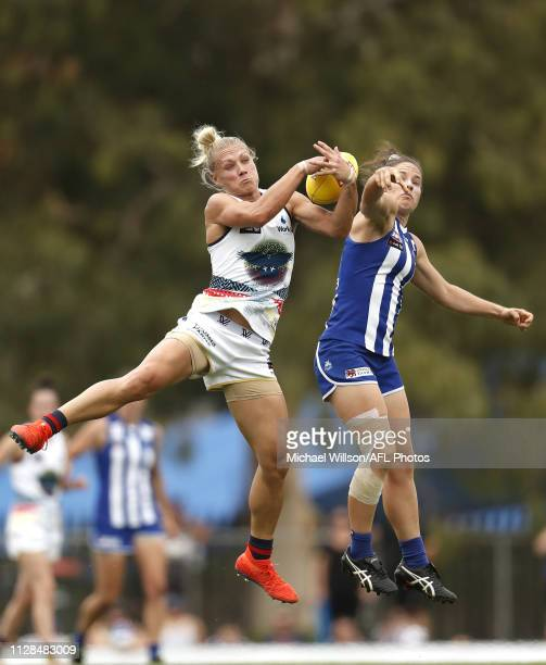 Erin Phillips of the Crows and Emma Kearney of the Kangaroos contest the ball during the 2019 NAB AFLW Round 05 match between the North Melbourne...