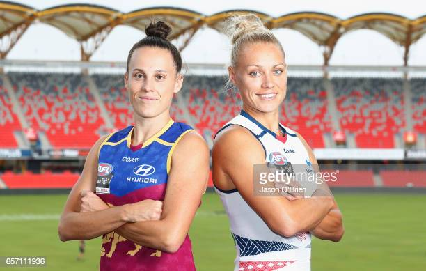 Erin Phillips of the Crows and Emma Zielke of the Lions pose for a photo during the Women's AFL Grand Final press conference at Metricon Stasium on...