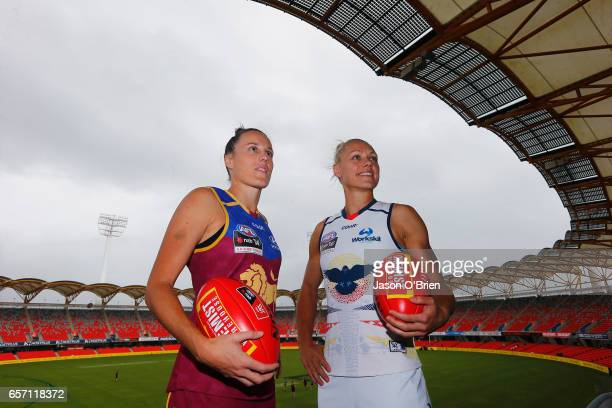 Erin Phillips of the Crows and Emma Zielke of the Lions pose for a photo during the Women's AFL Grand Final press conference at Metricon Stadium on...