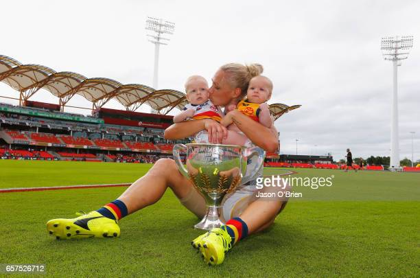 Erin Phillips of the Crows celebrates with her twins Blake and Brooklyn during the AFL Women's Grand Final between the Brisbane Lions and the...