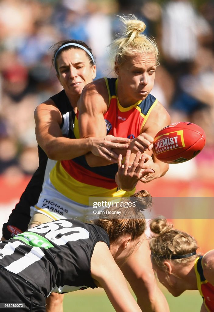 Erin Phillips of the Crows handballs whilst being tackled during the round seven AFLW match between the Collingwood Magpies and the Adelaide Crows at Olympic Park on March 18, 2018 in Melbourne, Australia.