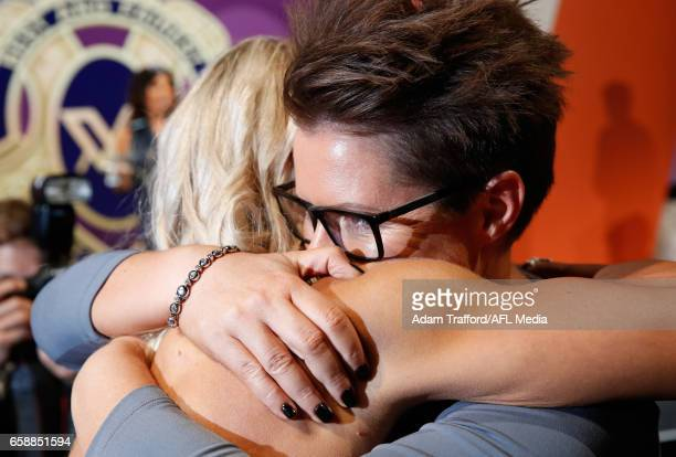 Erin Phillips of the Crows is hugged by Coach Bec Goddard after being announced as the inaugural AFLW Best and Fairest winner during the The W Awards...