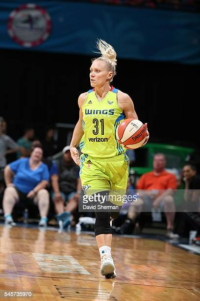 Erin Phillips of the Dallas Wings brings the ball up court against the Minnesota Lynx during a WNBA game on July 9 2016 at Target Center in...