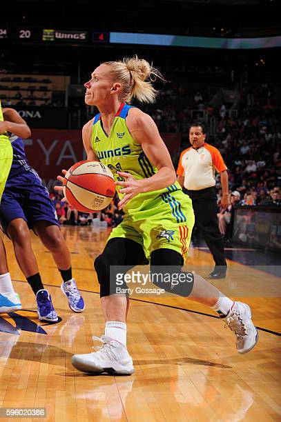 Erin Phillips of the Dallas Wings drives to the basket against the Phoenix Mercury on August 26 2016 at Talking Stick Resort Arena in Phoenix Arizona...