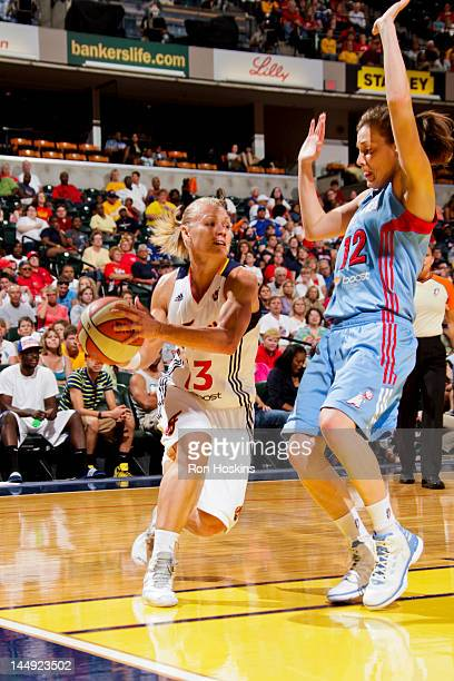 Erin Phillips of the Indiana Fever drives against Laurie Koehn of the Atlanta Dream at Bankers Life Fieldhouse on May 19 2012 in Indianapolis Indiana...