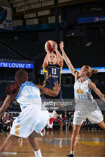 Erin Phillips of the Indiana Fever shoots against Allie Quigley of the Chicago Sky during the game on August 06 2013 at the Allstate Arena in...
