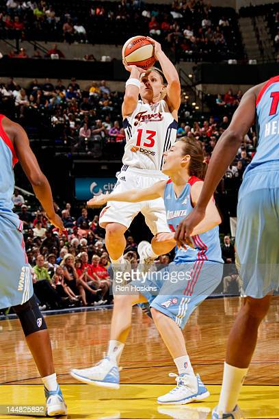 Erin Phillips of the Indiana Fever shoots against Laurie Koehn of the Atlanta Dream at Bankers Life Fieldhouse on May 19 2012 in Indianapolis Indiana...