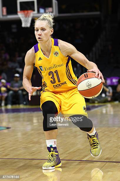 Erin Phillips of the Los Angeles Sparks brings the ball up court against the Minnesota Lynx at Staples Center on June 16 2015 in Los Angeles...