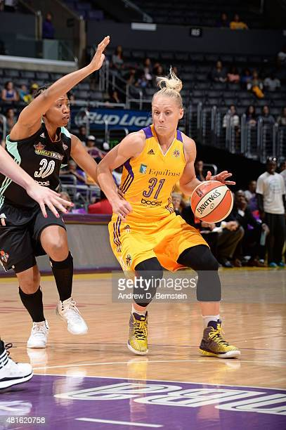 Erin Phillips of the Los Angeles Sparks dribbles the ball against Tanisha Wright of the New York Liberty on July 22 2015 at Staples Center in Los...