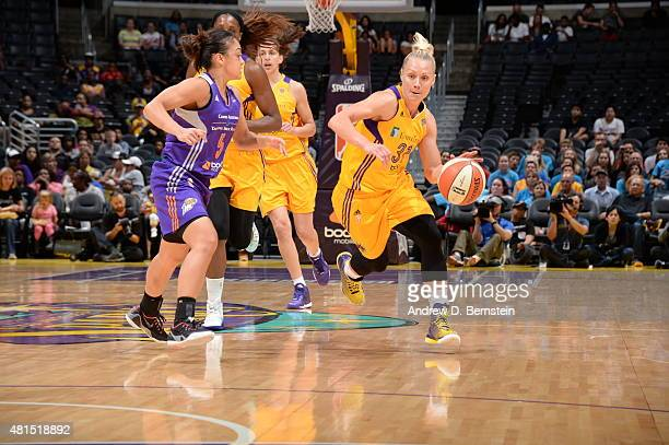 Erin Phillips of the Los Angeles Sparks dribbles the ball against the Phoenix Mercury on July 21 2015 at Staples Center in Los Angeles California...