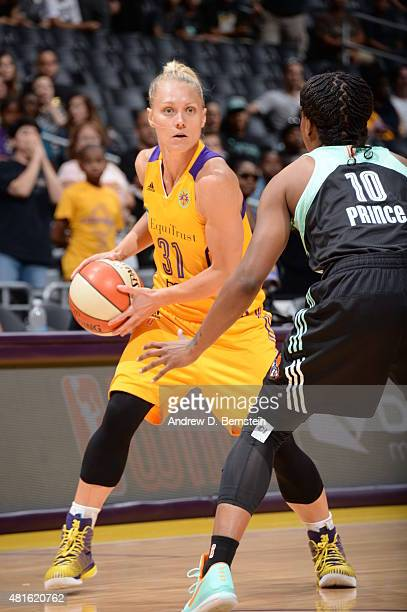 Erin Phillips of the Los Angeles Sparks handles the ball against Epiphanny Prince of the New York Liberty on July 22 2015 at Staples Center in Los...