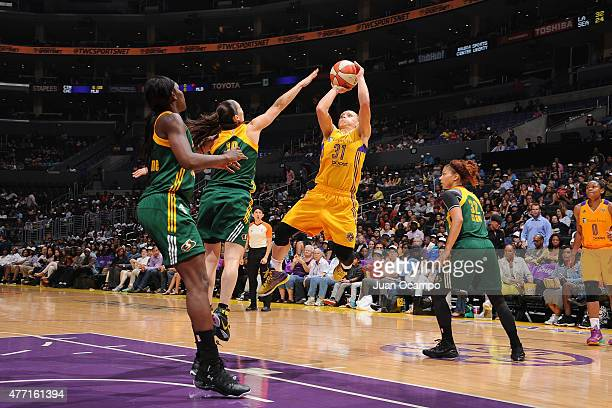 Erin Phillips of the Los Angeles Sparks shoots the ball against the Seattle Storm on June 14 2015 at STAPLES Center in Los Angeles California NOTE TO...