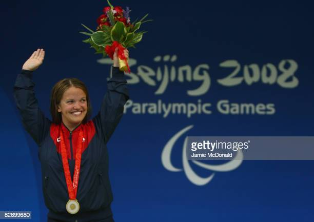 Erin Popovich of the USA celebrates winning Gold in the women's 200m individual medley - SM7 at the National Aquatics Centre on September 7, 2008 in...