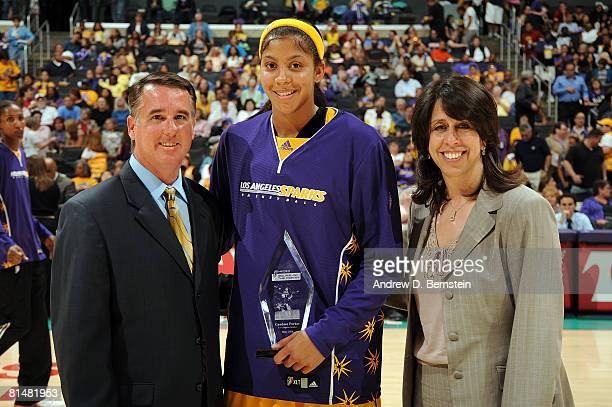 Erin Rippee Director of Marketing Business Development for HANNSpree WNBA President Donna Orender present Candace Parker of the Los Angeles Sparks...