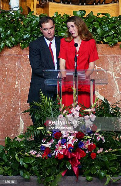 Erin Runnion, accompanied by her husband Ken Donnelly, speaks during the funeral of her 5 year old daughter Samantha Runnion at the Crystal Cathedral...