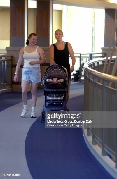 Erin Sampson right pushes her stroller with her infant daughter Abby accompanied by Alyson Jiron at the Paul Derda Recreation Center on Tuesday