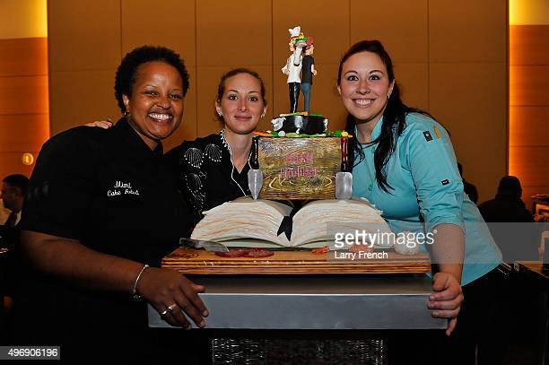 Erin Schwartz and her team pose with their cake at DC Central Kitchen's Capital Food Fight at the Ronald Reagan Building on November 12 2015 in...