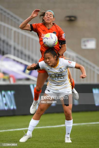 Erin Simon of Houston Dash jumps over Arielle Ship of the Utah Royals FC in the first round of the NWSL Challenge Cup at Zions Bank Stadium on June...