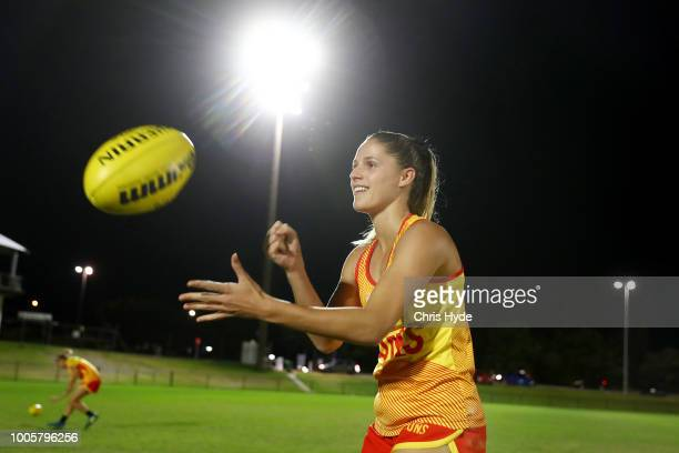 Erin Sundstrom handballs during a Suns training session ahead of the round two AFLW Winter Series match between the Gold Coast Suns and the Southern...