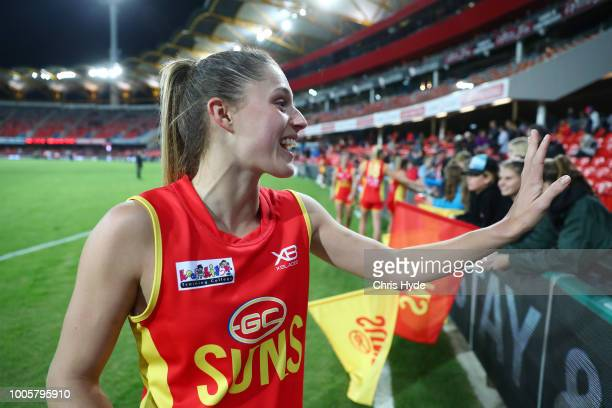 Erin Sundstrom of the Suns waves to family after the AFLW Winter Series match between the Gold Coast Suns and the Brisbane Lions at Metricon Stadium...