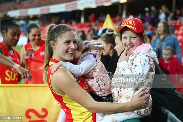 Erin Sundstrom of the Suns with her sisters after the AFLW Winter Series match between the Gold Coast Suns and the Brisbane Lions at Metricon Stadium...