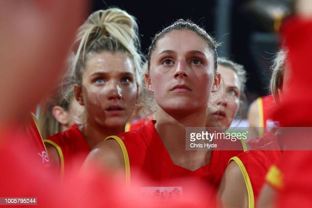 Erin Sunstrom and the Suns huddle during the AFLW Winter Series match between the Gold Coast Suns and the Brisbane Lions at Metricon Stadium on July...