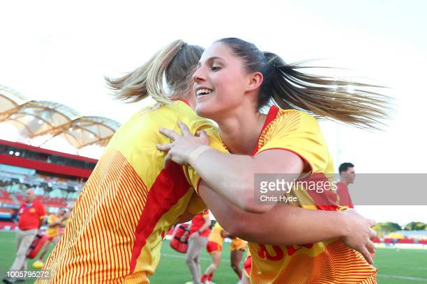 Erin Sunstrom and the Suns warm up before the AFLW Winter Series match between the Gold Coast Suns and the Brisbane Lions at Metricon Stadium on July...