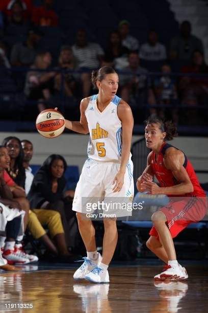 Erin Thorn of the Chicago Sky looks to pass the ball against Kelly Miller of the Washington Mystics during the WNBA game on July 5 2011 at the...