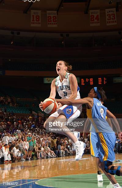 Erin Thorn of the New York Liberty goes to the basket against Chelsea Newton of the Chicago Sky at Madison Square Garden on August 5 2006 in New York...