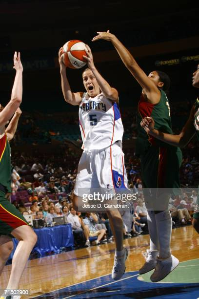 Erin Thorn of the New York Liberty shoots against the Seattle Storm during the game at Madison Square Garden on July 22 2006 in New York City NOTE TO...