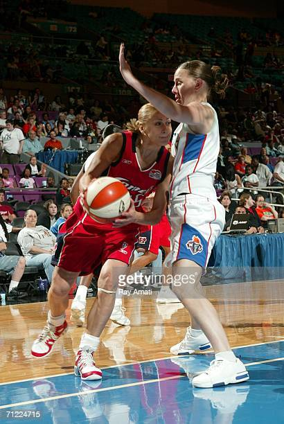 Erin Thorn of the NY Liberty guards against Anastasia Kostaki of the Houston Comets at the Houston Comets vs the New York Liberty game on June 16...