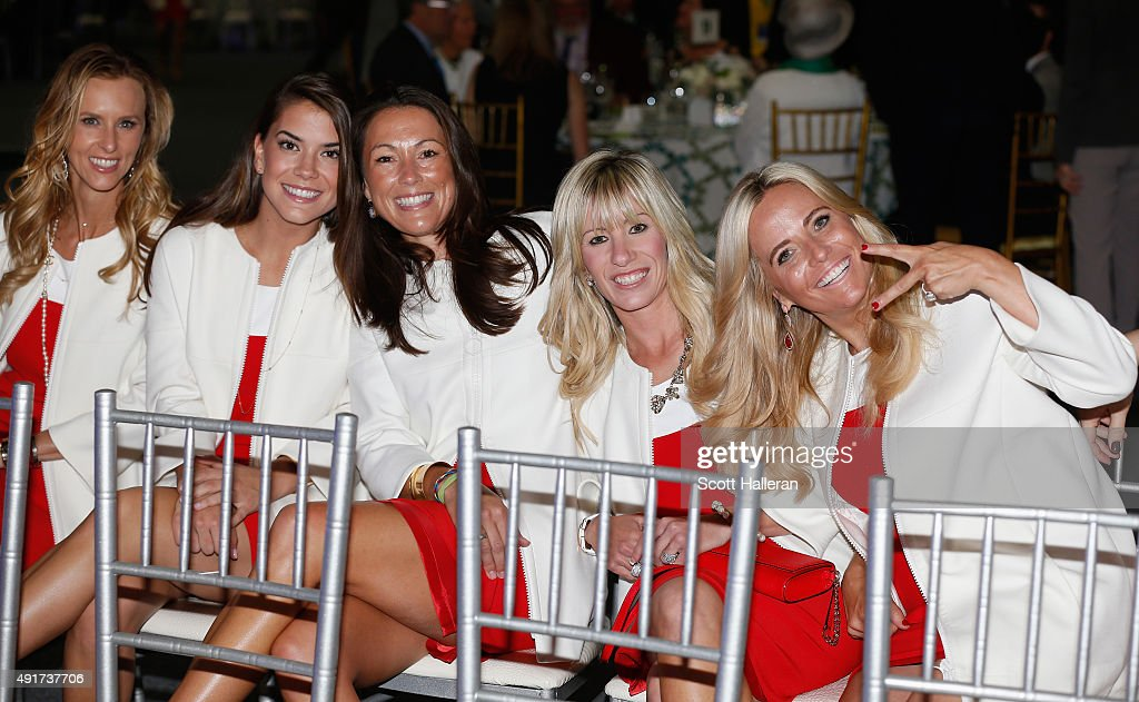 Erin Walker, Annie Verret, Sybi Kucher, Justine Reed and Amy Mickelson of the United States pose for a picture during the opening ceremony of the 2015 Presidents Cup at the Convensia Ceremony Hall on October 7, 2015 in Incheon City, South Korea.