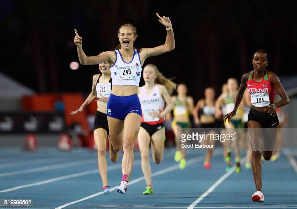 Erin Wallace of Scotland celebrates after crossing the finish line to win the Girls 1500m Final ahead of Viola Chemutai of Kenya and Katrina Robinson...