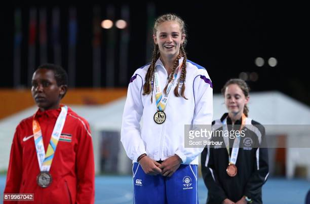 Erin Wallace of Scotland Viola Chemutai of Kenya and Katrina Robinson of New Zealand pose with their medals after the Girls 1500m Final during the...