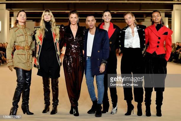 Erin Wasson, Julia Hengel, Helena Christensen, Olivier Rousteing, Caroline Ribeiro, Esther Canadas and Liya Kebede walk the runway during the Balmain...