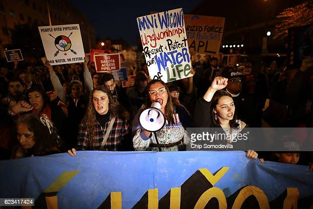 Erin Wise of Cannon Ball North Dakota leads a protest march from the Army Corps of Engineers to the White House to demonstration against the proposed...